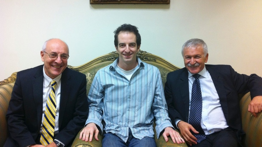 Oct. 26, 2011: Ilan Grapel, a U.S.-Israeli citizen arrested in Egypt sits between Israel Hasson, right, and lawyer Yitzhak Molcho, left, in Cairo, Egypt.