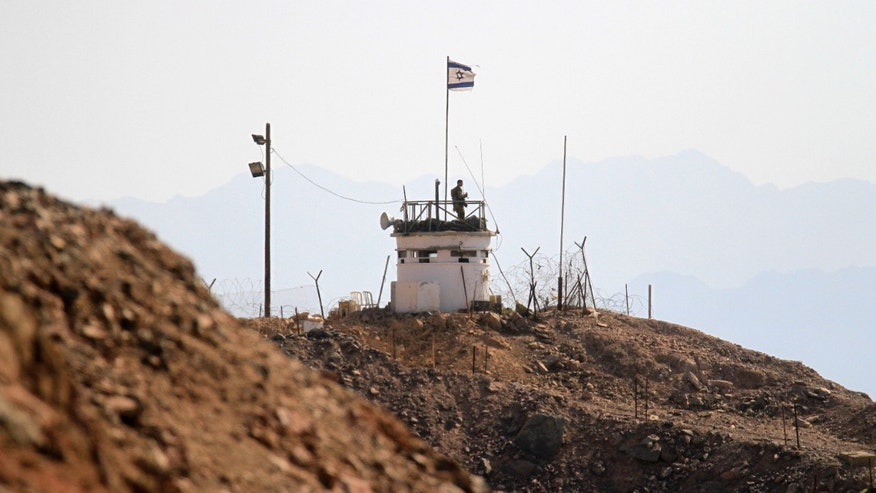 Oct. 27, 2011: An Israeli soldier stands atop an observation tower on the Israeli side of the border line with Egypt, near to the town of Taba, in the south of Egypt's Sinai Peninsula.