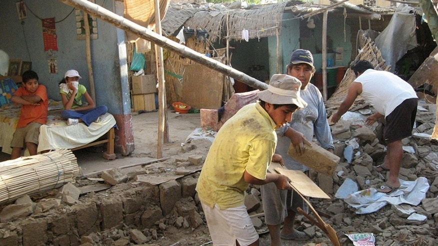Oct. 28, 2011: People remove bricks after a magnitude-6.9 earthquake hit the area in Ica, Peru.