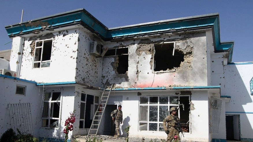 October 31: A US soldier and an Afghan security man, check the damage at offices of the U.N.'s refugee agency, the UNHCR, caused by a suicide bomber, in Kandahar, Afghanistan.