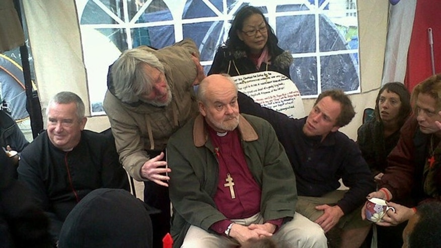 "Oct. 30, 2011: The Right Reverend Richard Chartres, Bishop of London, center, and Dean of St Paul's Cathedral, The Right Reverend Graeme Knowles, left, meet a select group from the Occupy London movement in ""the tea tent"" at St Paul's before addressing protesters on the steps of the cathedral."