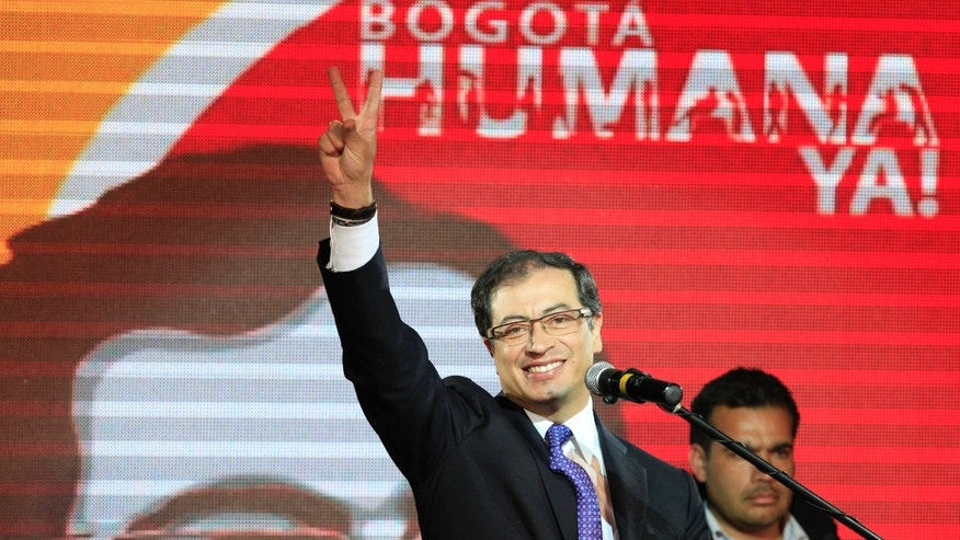 Oct. 30: Gustavo Petro gestures to supporters as he celebrates winning Bogota's mayoral race in Bogota, Colombia.