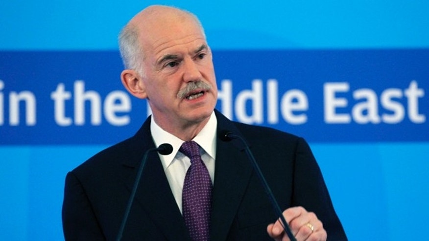 July 1: Greek Prime Minister George Papandreou, gives a speech during a European Socialist parties conference, in Athens.