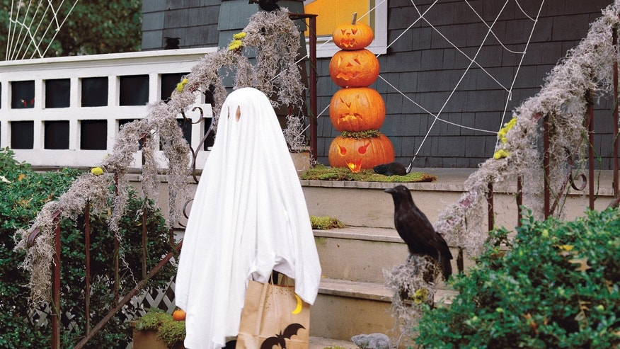 This photo courtesy of Martha Stewart Living Omnimedia, Inc., William Waldron, shows the front of a home decorated for Halloween originally published in the 2011 Martha Stewart Halloween Special Issue.  Dressing up is the name of the game on Halloween, but it's just as much fun to dress up the front of the house.     (AP Photo/Martha Stewart Living Omnimedia, Inc., William Waldron)