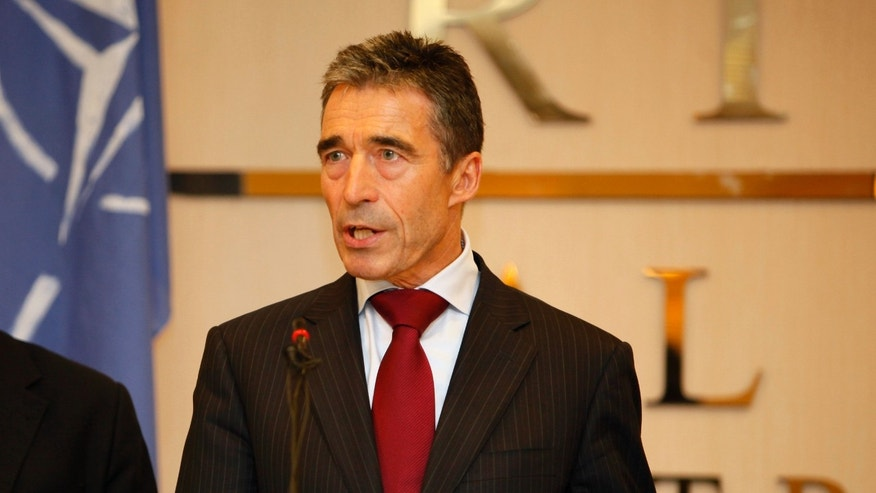 "October 31: NATO Secretary-General Anders Fogh Rasmussen speaks to reporters in Tripoli, Libya. NATO's top official is praising the Libyans for their ""courage, determination and sacrifice"" to oust dictator Moammar Gadhafi, and says they have transformed Libya and ""helped change the region."""