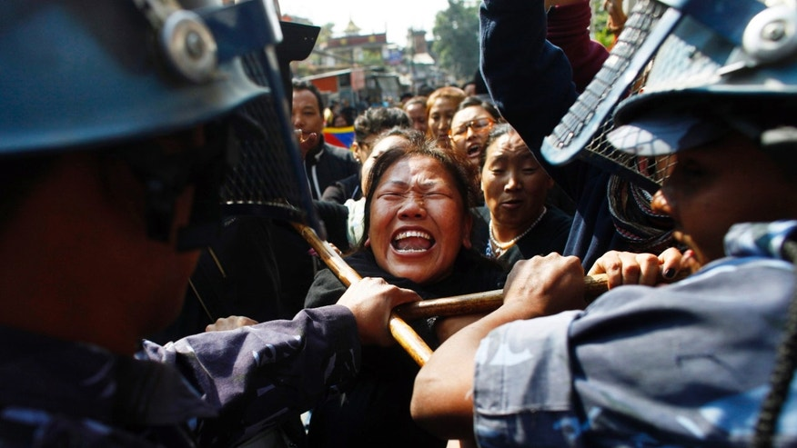 Nov. 1, 2011: Nepal police detain a Tibetan who was shouting anti-China slogans in tribute to the Tibetans who died in the recent self-immolation, in Katmandu, Nepal.