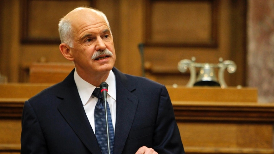 Oct. 31, 2011: Greek Prime Minister George Papandreou addresses Socialist members of parliament in Athens. Papandreou says his country will hold a referendum on a new European debt deal reached last week. Papandreou gave no date on other details of a proposed referendum on the deal that aims to seek 50 percent losses for private holders of Greek bonds and provide the troubled eurozone member with euro 100 billion ($140 billion) in additional rescue loans.