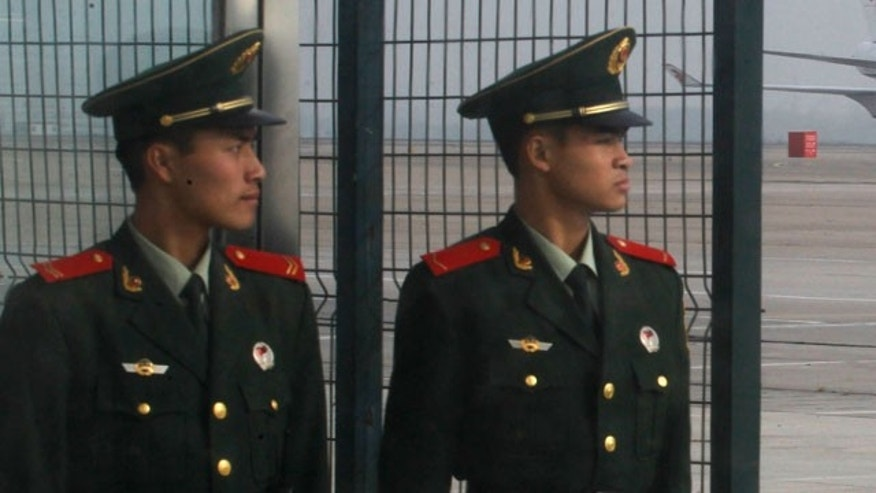 Oct. 28, 2011: Chinese paramilitary police officers stand guard as Chinese jetliner powered by biofuel lands after completing an inaugural flight from the airport in Beijing, China.