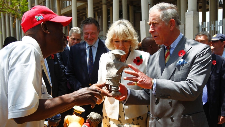 Nov. 3, 2011: Britain's Prince Charles and his wife Camilla, Duchess of Cornwall, look at local crafts during their visit to Soweto, South Africa.