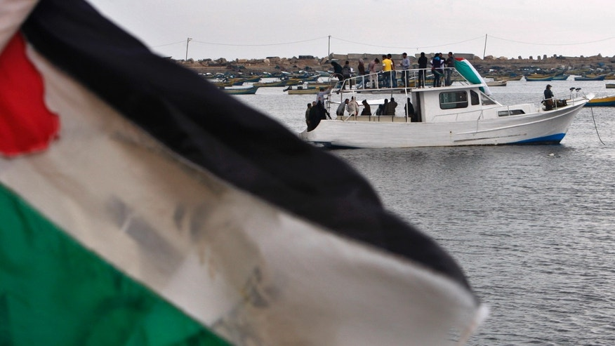Nov. 4, 2011:alestinian and foreign activists sail on a boat during a protest to show their support for two boats carrying 27 civilians from various countries attempting to reach the Gaza Strip.