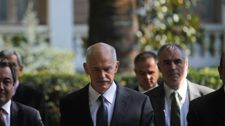 Nov. 5, 2011: Greece's Prime Minister George Papandreou exits Presidential house after meeting with Greek President Karolos Papoulias, in Athens.