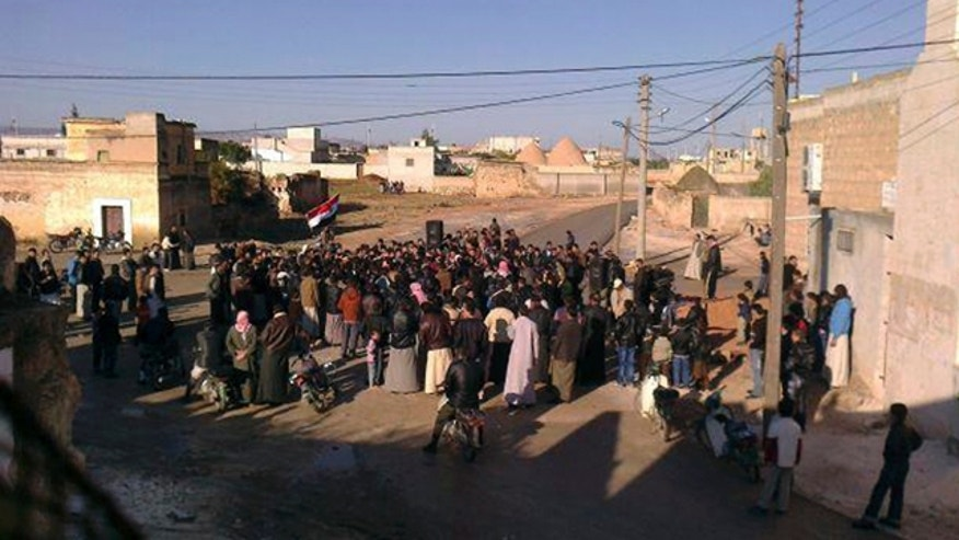 Nov. 6, 2011: In this citizen journalist's image made with a mobile phone and provided by Shaam News Network, Syrian protesters stage a demonstration against the Syrian President Bashar Assad's regime at Mreidekh village in Edlib province, northern Syria, according to the source.