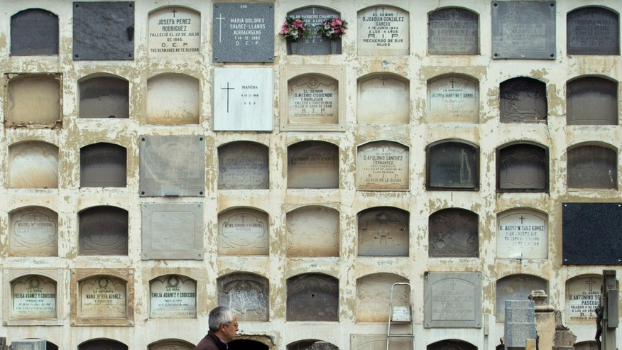 Pushed for space, a Spanish cemetery in Torrero near Zaragoza has begun placing stickers on thousands of burial niches whose leases are up as a warning to relatives or caretakers to pay up or face possible eviction.