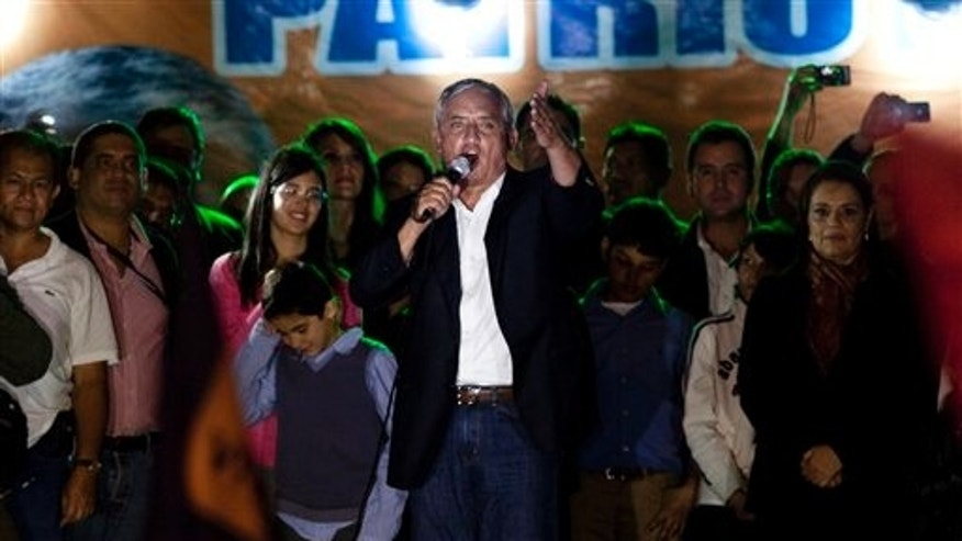 November 7: Patriotic Party presidential candidate, Otto Perez Molina, greets supporters  celebrating his victory in Guatemala City.
