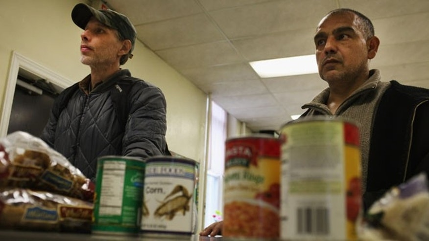 READING, PA - OCTOBER 19:  Men wait for groceries at the Central Park United Methodist Church weekly food pantry on October 19, 2011 in Reading, Pennsylvania. The U.S. Census says in a report released Nov. 7, 2011, that 28 percent of Latinos across the country live below the poverty line.  (Photo by Spencer Platt/Getty Images)