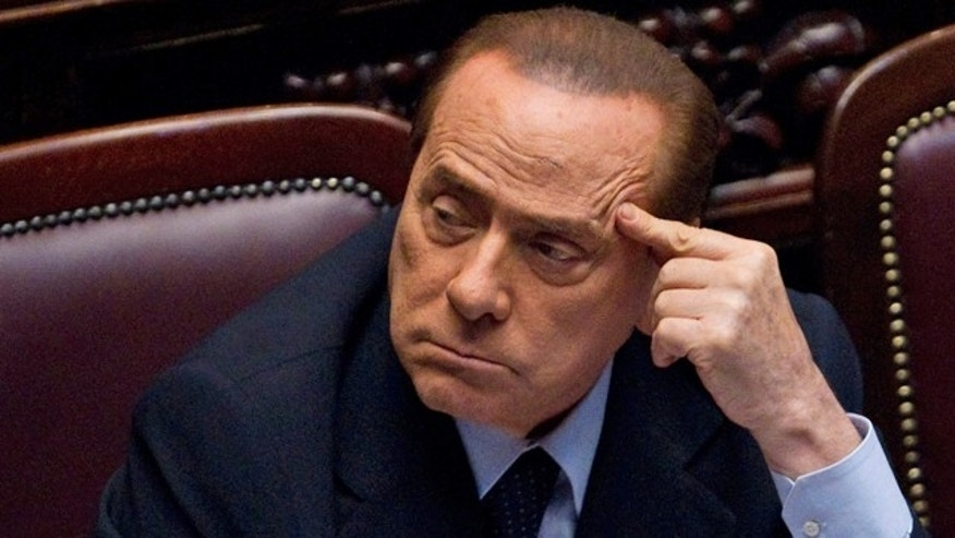 July 15, 2011: FILE - Italian Premier Silvio Berlusconi votes over a crucial euro70 billion ($99 billion) austerity package aimed at convincing investors that the eurozone's third-largest economy won't be swept into the debt crisis, at the lower house of parliament, in Rome.