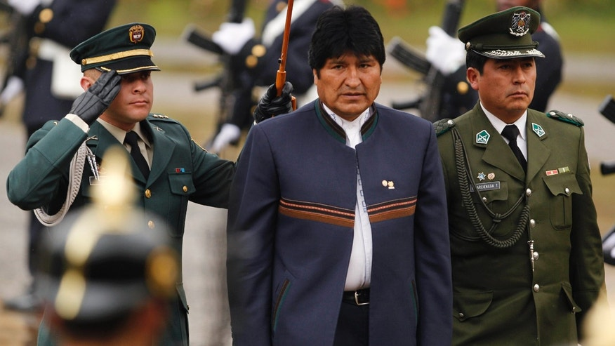 Bolivia's President Evo Morales arrives for an Andean Community of Nations meeting at the presidential palace in Bogotá, Colombia. (AP Photo/Fernando Vergara)