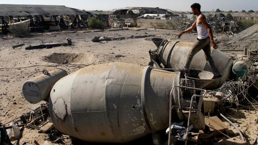 Nov. 9, 2011: A Palestinian inspects the damage caused by an overnight Israeli air strike in Khan Younis, southern Gaza Strip.
