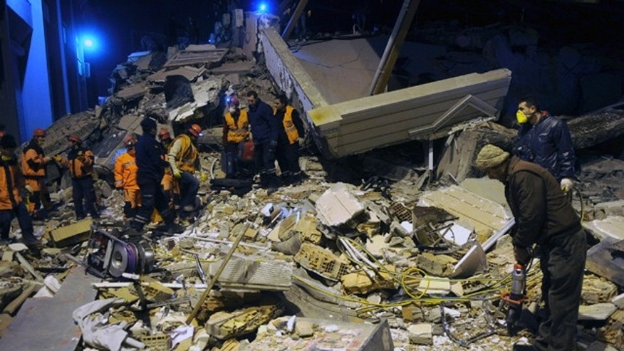 Nov. 9: Rescuers search for survivors in the rubble of a collapsed hotel in Van, eastern Turkey.