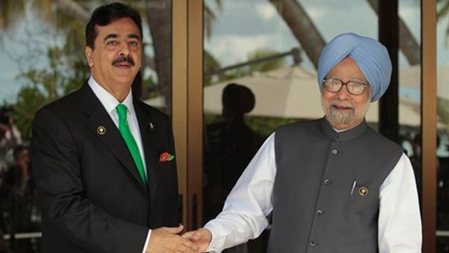 November 10, 2011: Pakistani Prime Minister Yousuf Raza Gilani, left, shakes hands with Indian Prime Minister Manmohan Singh on the sidelines of the South Asian Association for Regional Cooperation (SAARC) summit in Addu, Maldives.