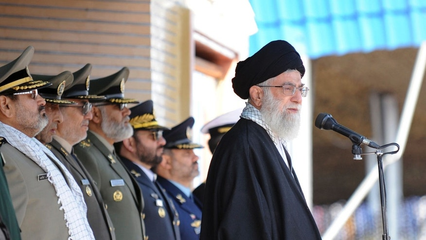 Nov. 10, 2011: Iranian supreme leader Ayatollah Ali Khamenei, right, stands at the podium in front of high ranking armed forces members, during a ceremony in a military university, in Tehran, Iran.
