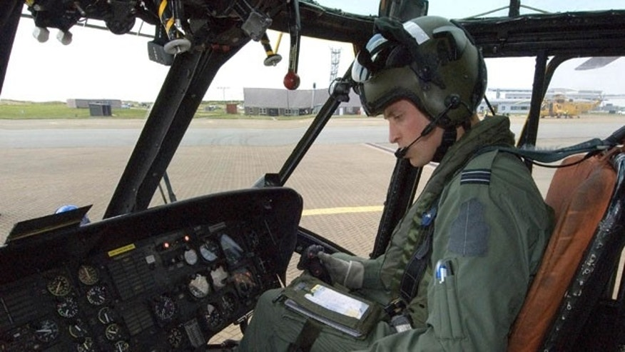 This image released by the British Ministry of Defense on Friday Sept. 17, 2010 shows Prince William at the controls of his Sea King helicopter in Bangor, Wales.