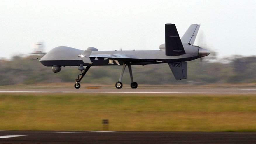 A Predator B unmanned aircraft lands after a mission at the Naval Air Station, Tuesday, Nov. 8, 2011, in Corpus Christi, Texas. Using the same technology responsible for lethal strikes elsewhere in the world, U.S. Customs and Border Protection is expanding its use of Predator B unmanned aircraft outfitted with powerful infrared cameras and sensitive radar to patrol U.S. borders. (AP Photo/Eric Gay)
