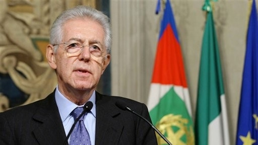 "Nov. 13, 2011: Italy's new premier-designate economist Mario Monti meets with journalists at the Quirinale Presidential Palace after talks with Italian President Giorgio Napolitano in Rome. Monti told reporters Sunday night he will carry out the task ""with a great sense of responsibility and service toward this nation."""