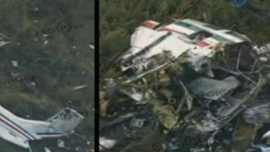 In this video frame grab image taken from Televisa's Forotv via APTN, the wreckage of a helicopter carrying Mexico's Interior Minister Francisco Blake Mora is seen in a mountainous area of Mexico state southeast of Mexico City, Friday Nov. 11, 2011. The Mexican government said Friday, that Mora, Mexico's No. 2 government official next to the president, died in the helicopter crash with seven others, including the pilot. (AP Photo/Forotv-Televisa via APTN)