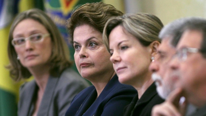 Brazil's President Dilma Rousseff, second from left, and her ministers attend a ceremony at which Rousseff signed a law establishing a truth commission in Planalto presidential palace in Brasilia, Brazil, Friday Nov. 18, 2011. (AP Photo/Eraldo Peres)