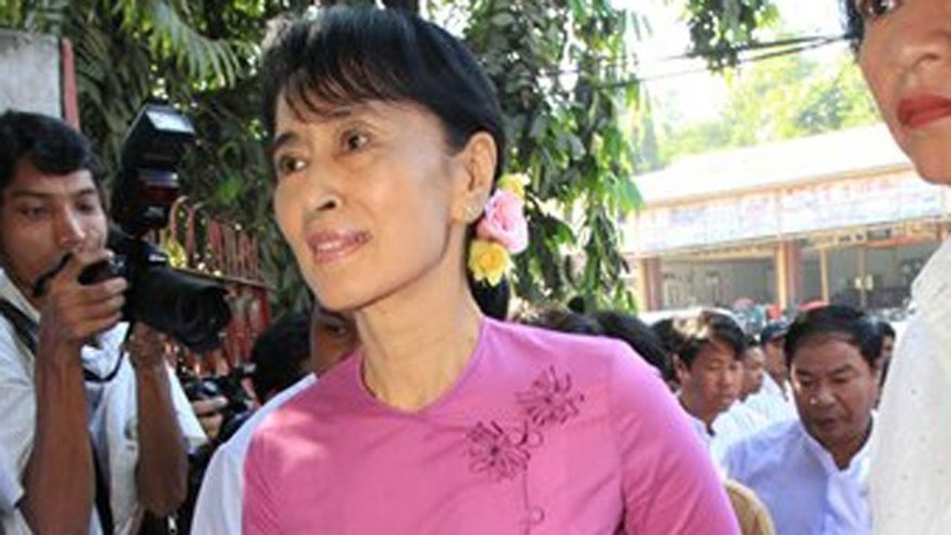 November 18, 2011: Burma democracy icon Aung San Suu Kyi arrives at her National League for Democracy (NLD) party's headquarters to attend a meeting.