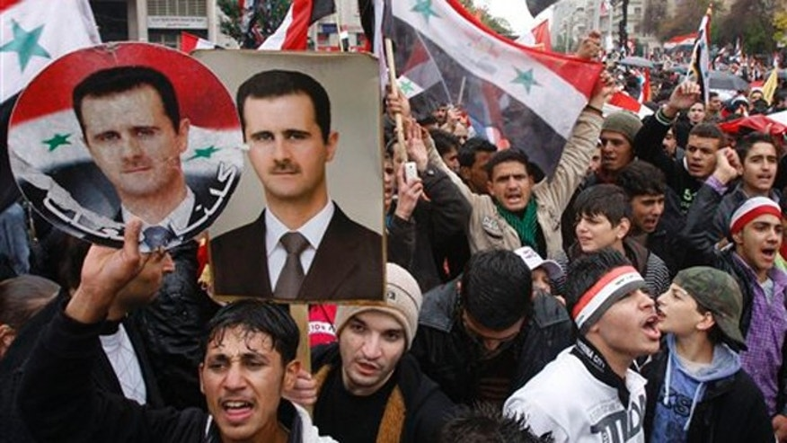 November 16, 2011: Pro-Syrian regime protesters, shout pro-Syrian President Bashar Assad slogans during a demonstration in Damascus, Syria.