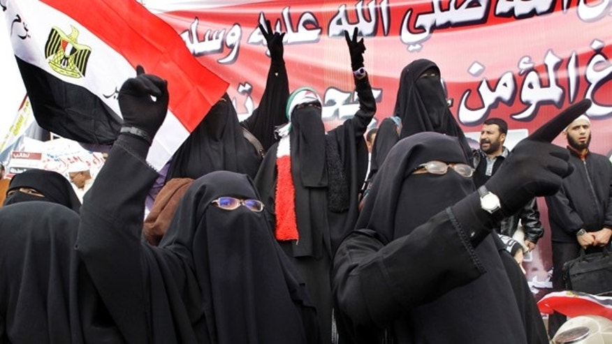 "Nov. 18, 2011: Egyptian women wearing the ""Niqab""  shouts slogans during a rally in Cairo's Tahrir square, Egypt."