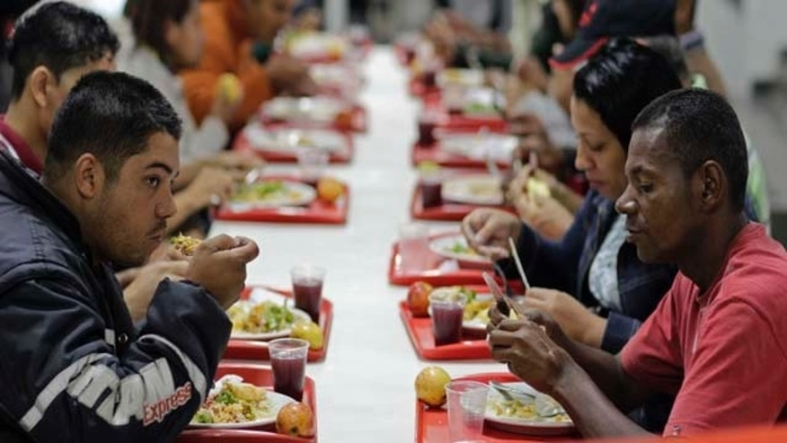 "In this picture taken July 22, 2011, people eat at a popular restaurant sponsored by the Brazilian government in Sao Paulo, Brazil. Jose Graziano da Silva, the new Director-General of the UN Food and Agriculture Organization (FAO) and former Brazilian food security minister, is one of the creators of the nation's ""Zero Hunger"" social programs which includes ""Bolsa Familia"" or ""Family Grant"", the biggest program that gives money directly to poor households. That same idea may now get a global tryout as world food prices spike, economies everywhere sputter and a horrific famine desolates East Africa. (AP Photo/Andre Penner)"