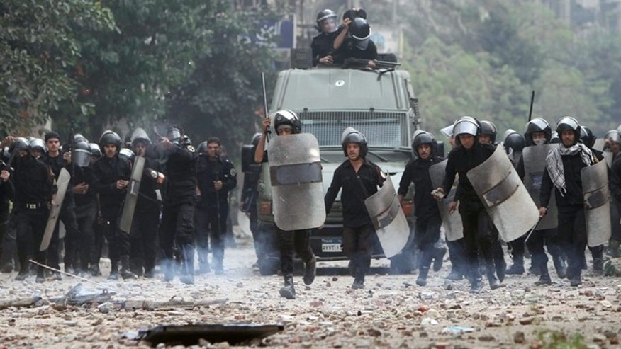 Nov. 20, 2011: Egyptian riot police are seen on the move during clashes with protesters in Tahrir Square in Cairo, Egypt.