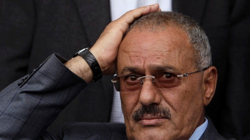 April 8: Yemeni President Ali Abdullah Saleh reacts while looking at his supporters, not pictured, during a rally supporting him, in Sanaa, Yemen. Saleh signed a deal Wednesday in the Saudi capital that would be the end of his 33-year rule, the U.N. envoy to Yemen said.