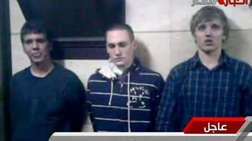 November 22, 2011: Three American students are displayed to the camera by Egyptian authorities following their arrest during protests in Cairo, where an Egyptian official said they were throwing firebombs at security forces.