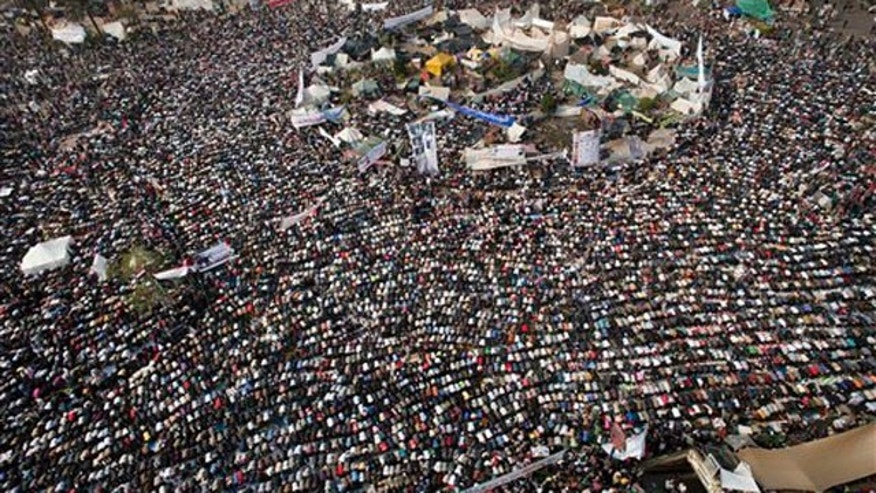 Thousands of Egyptians perform Friday prayers during a rally in Tahrir Square in Cairo, Egypt, Friday, Nov. 25, 2011.