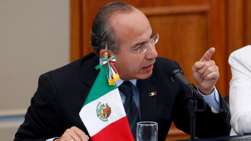 Mexico's President Felipe Calderon, gestures during a meeting with victims of violence in Mexico City, Thursday June 23, 2011. Calderon says he doesn't regret his strategy to fight organized crime, despite calls to end a confrontation that has killed at least 35,000 during his administration. (AP Photo/Eduardo Verdugo)