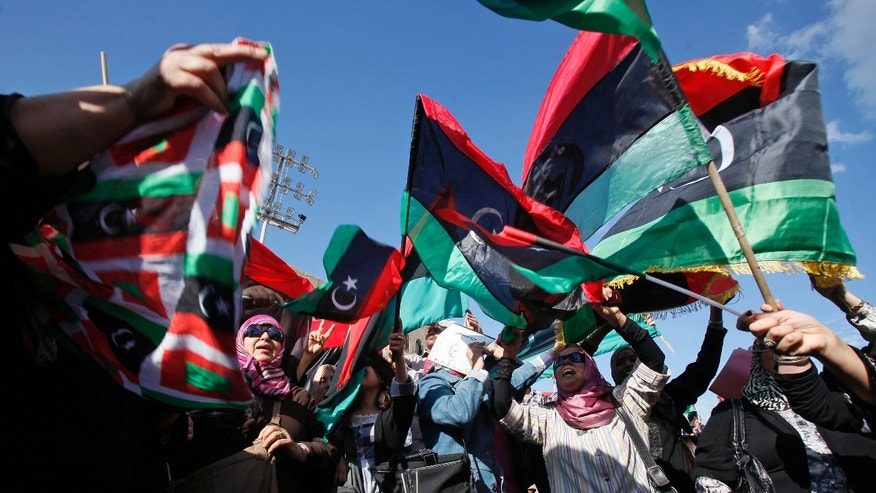 Nov. 19, 2011: Women wave pre-Gadhafi flags during a celebration of the capture of Seif al-Islam Qaddafi in Tripoli, Libya.