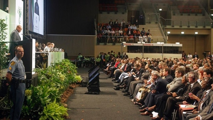 Nov. 28, 2011: South African President Jacob Zuma, left back, speaks during the opening ceremony of a climate conference as delegates listen in the city of Durban, South Africa.