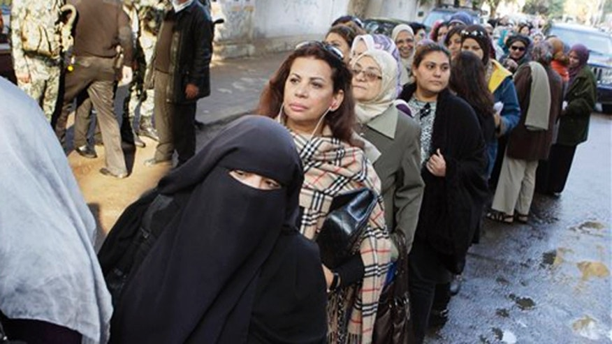 November 28, 2011: Egyptian women line up out side a polling center in Cairo, Egypt.