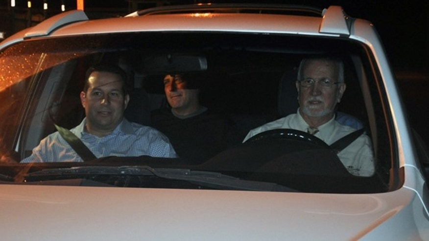 Nov. 29: Gary Giordano, center, pictured shortly after being freed from police custody, sitting in the back of an SUV driven away from an Aruban detention facility by local lawyer Chris Lejuez, and American lawyer Jose Baez, left, in Oranjestad, Aruba.