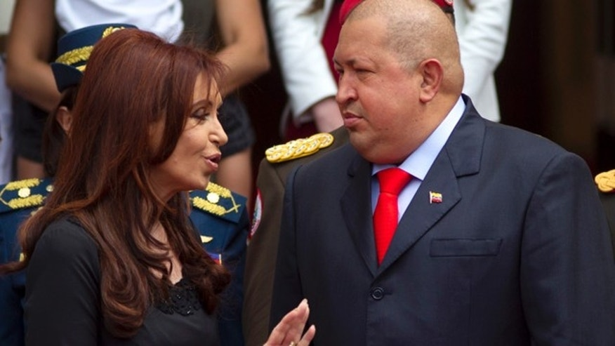 Dec. 1: Argentinas President Cristina Fernandez speaks with Venezuelas President Hugo Chavez during a ceremony upon Fernandezs arrival to Miraflores presidential palace in Caracas.