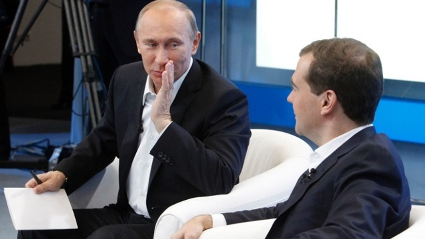 Dec. 1: Russia's President Dmitry Medvedev, right, and Prime Minister Vladimir Putin meet with supporters in Moscow.
