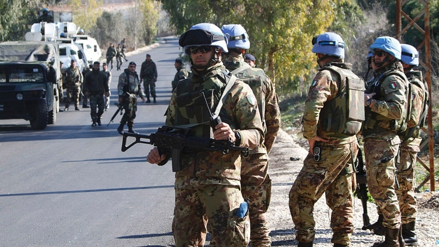 Nov. 29, 2011: Italian U.N. peacekeeper soldiers, foreground, and Lebanese army forces, background, patrol an area where rockets were fired from south Lebanon into north Israel, near the village of Ain Ebel, south of Lebanon.