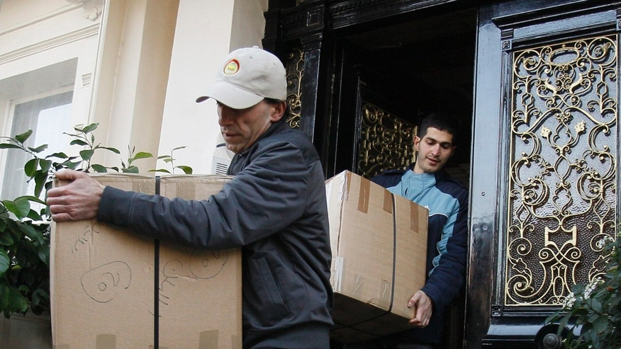 Dec. 2, 2001: Removal men carry packages from what is believed to be the residence of Iranian diplomats into a removal lorry in London.