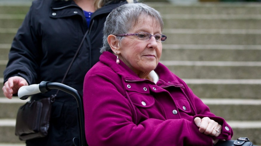 Dec. 1, 2011: Gloria Taylor arrives in a wheelchair at British Columbia Supreme Court in Vancouver, B.C. Taylor, who has Lou Gehrig's disease, is seeking the right to a doctor-assisted suicide in a challenge at B.C. Supreme Court.