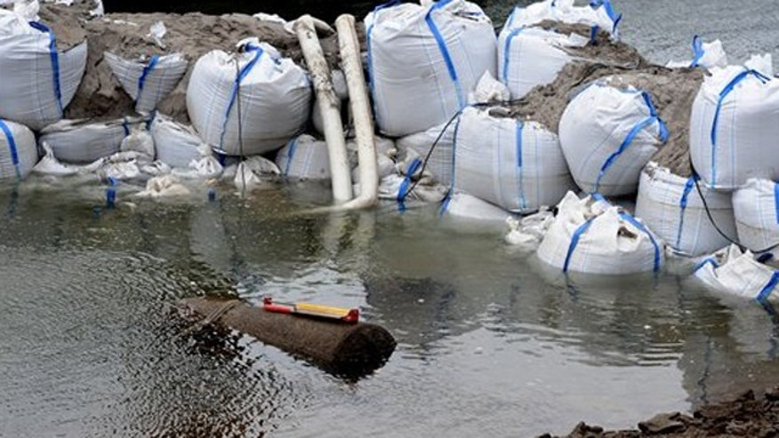 December 3, 2011: Sandbags frame a 1.8 ton WWII bomb  in river Rhine near Koblenz.