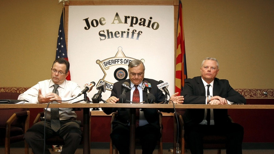 Maricopa County Sheriff Joe Arpaio, middle, Capt. Steve Whitney, left, and Chief Deputy Jerry Sheridan all pause as they discuss the latest in the document release on Arpaio's office's handling of many sexual assault cases over the years in El Mirage, Ariz., during a news conference, Monday, Dec. 5, 2011, in Phoenix. (AP Photo/Ross D. Franklin)